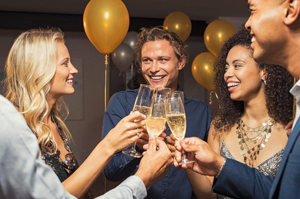 SuperLottoClub syndicate winners raising wine toast